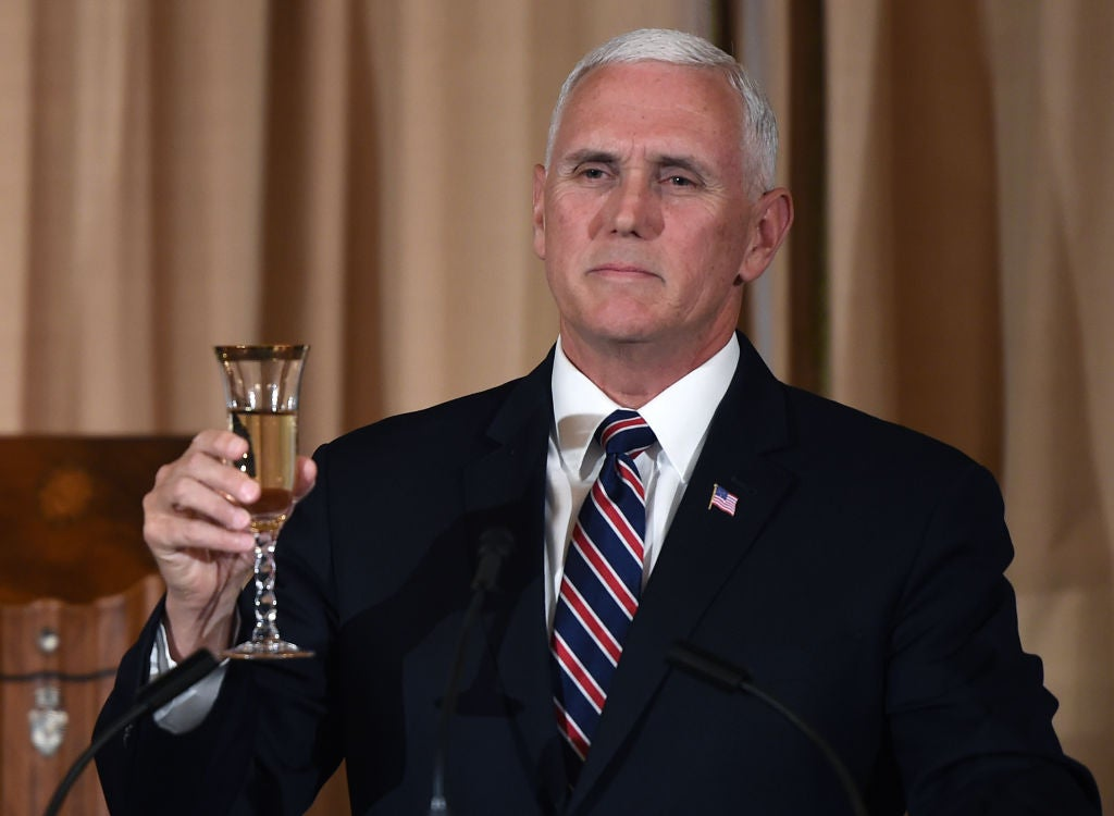 Mike Pence raises a glass for a toast.